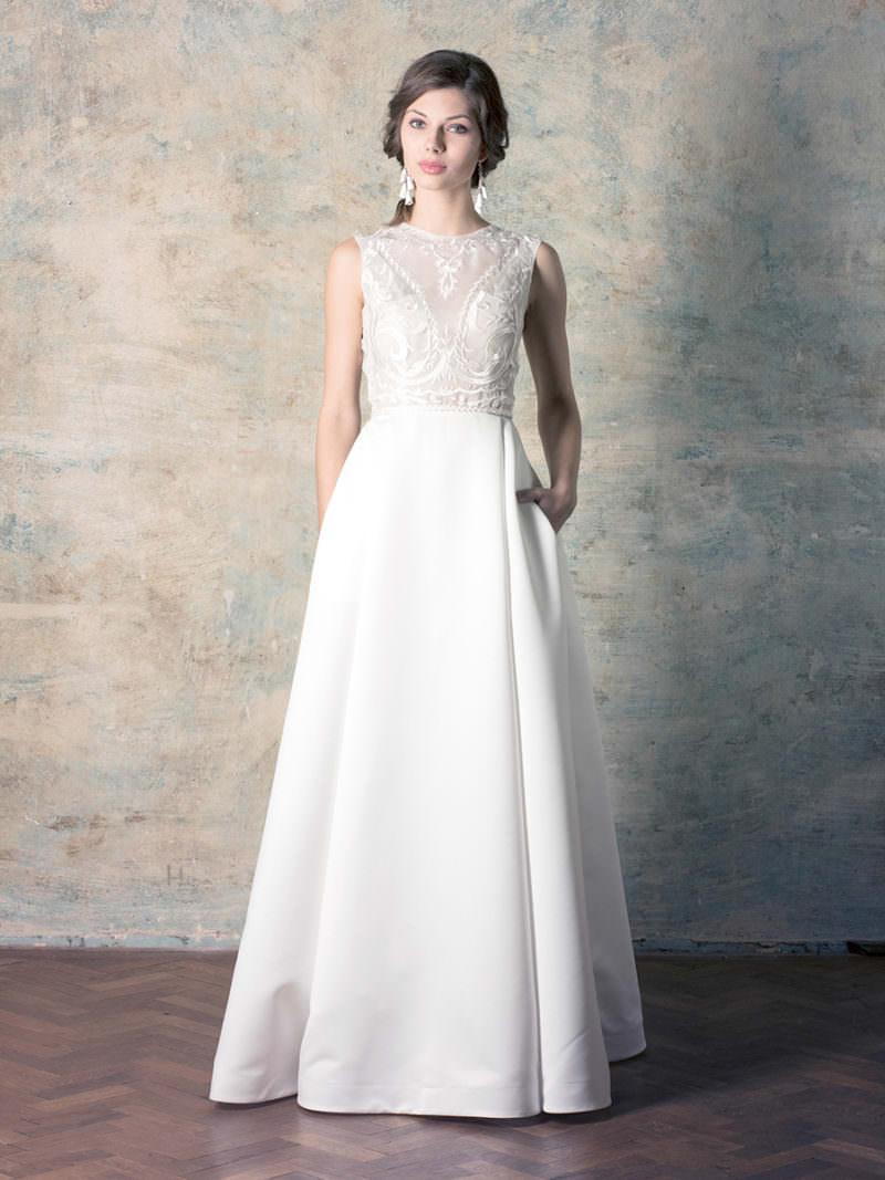 rochie de mireasă cu buzunare și broderie simplă și fustă groasă tip duchess